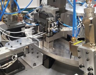 Laser welding station for automotive component